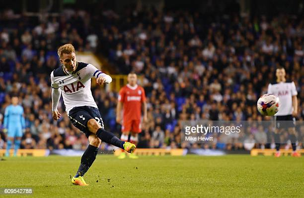 Christian Eriksen of Tottenham Hotspur scores his sides first goal during the EFL Cup Third Round match between Tottenham Hotspur and Gillingham at...