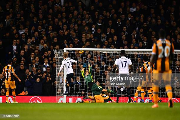 Christian Eriksen of Tottenham Hotspur scores his sides first goal during the Premier League match between Tottenham Hotspur and Hull City at White...