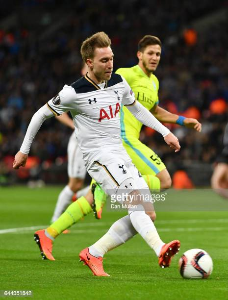 Christian Eriksen of Tottenham Hotspur scores his sides first goal during the UEFA Europa League Round of 32 second leg match between Tottenham...