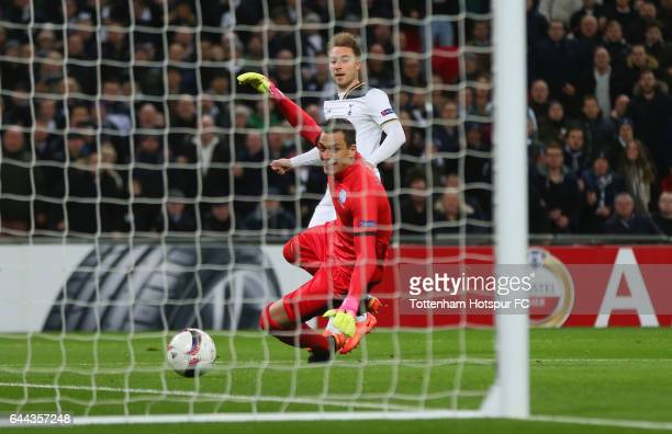 Christian Eriksen of Tottenham Hotspur scores his sides first goal during the UEFA Europa League Round of 32 second leg match between Tottenham...
