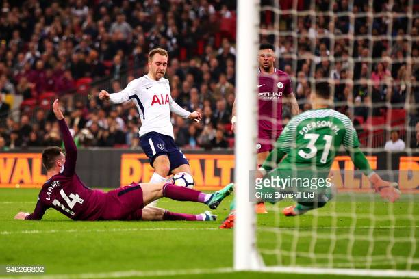 Christian Eriksen of Tottenham Hotspur scores his side's first goal during the Premier League match between Tottenham Hotspur and Manchester City at...