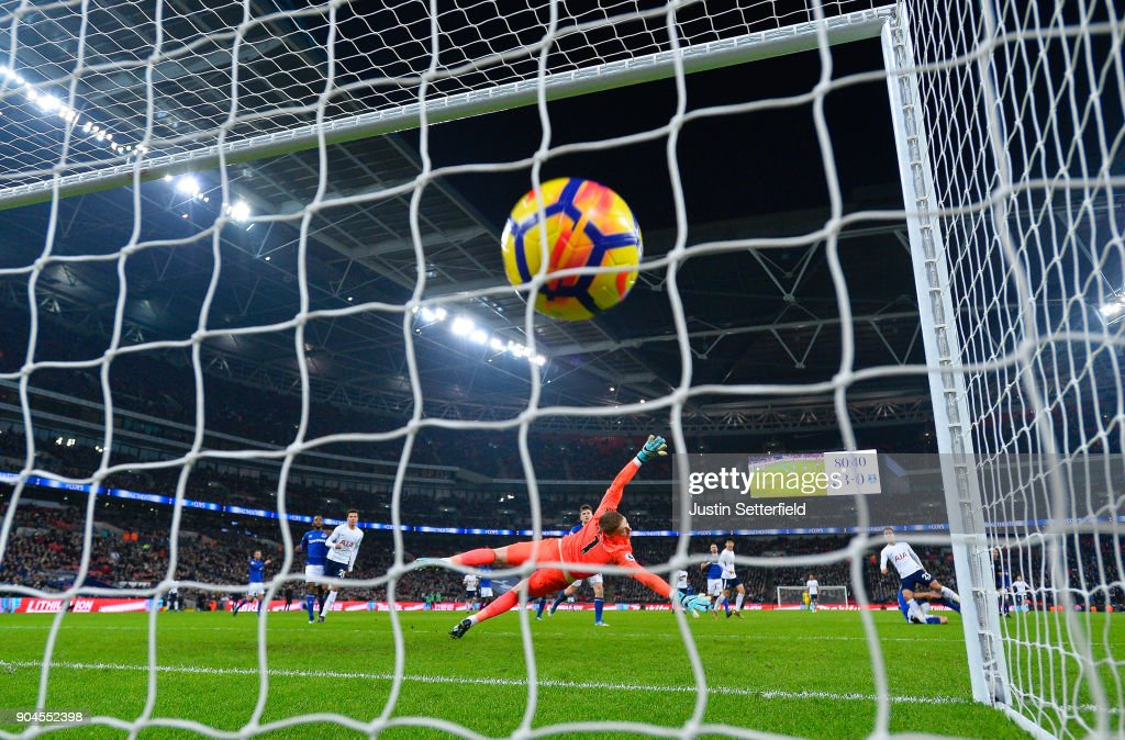 Christian Eriksen of Tottenham Hotspur scores his sides fourth goal during the Premier League match between Tottenham Hotspur and Everton at Wembley Stadium on January 13, 2018 in London, England.