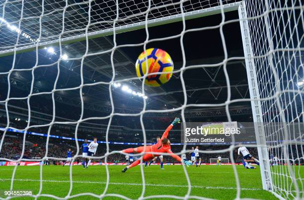 Christian Eriksen of Tottenham Hotspur scores his sides fourth goal during the Premier League match between Tottenham Hotspur and Everton at Wembley...