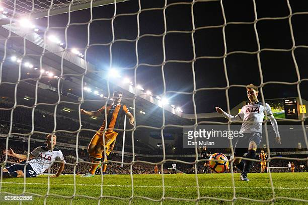 Christian Eriksen of Tottenham Hotspur scores his sides second goal during the Premier League match between Tottenham Hotspur and Hull City at White...