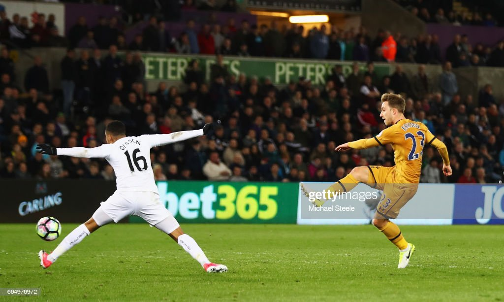 Christian Eriksen of Tottenham Hotspur scores his sides third goal during the Premier League match between Swansea City and Tottenham Hotspur at the Liberty Stadium on April 5, 2017 in Swansea, Wales.