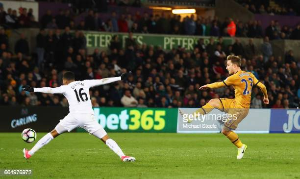 Christian Eriksen of Tottenham Hotspur scores his sides third goal during the Premier League match between Swansea City and Tottenham Hotspur at the...