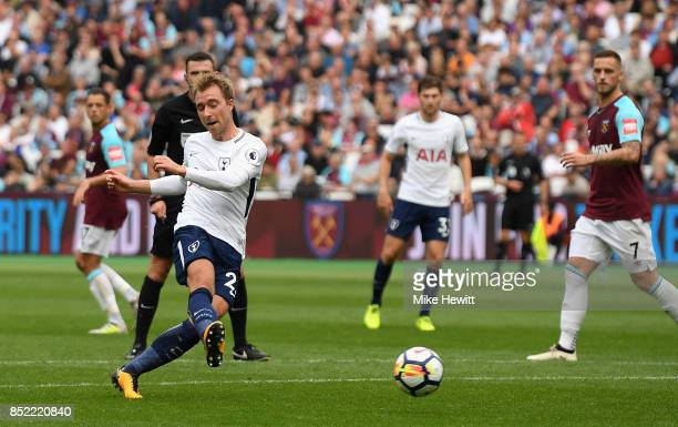 Christian Eriksen of Tottenham Hotspur scores his sides third goal during the Premier League match between West Ham United and Tottenham Hotspur at...