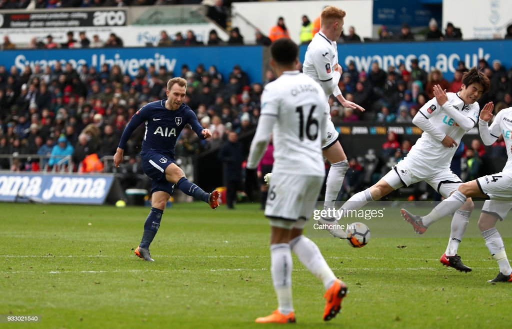 Christian Eriksen of Tottenham Hotspur scores his sides third goal during The Emirates FA Cup Quarter Final match between Swansea City and Tottenham Hotspur at Liberty Stadium on March 17, 2018 in Swansea, Wales.