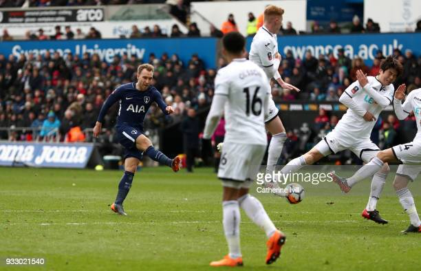 Christian Eriksen of Tottenham Hotspur scores his sides third goal during The Emirates FA Cup Quarter Final match between Swansea City and Tottenham...