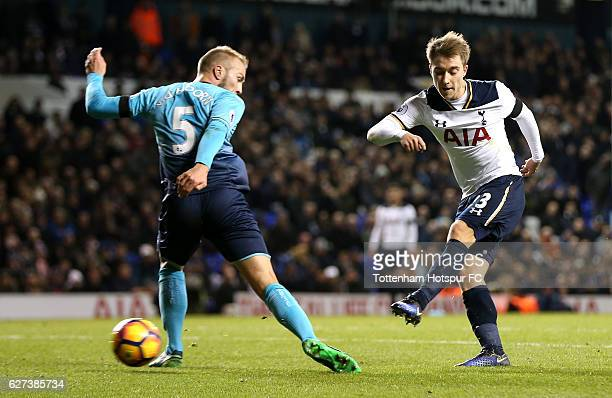 Christian Eriksen of Tottenham Hotspur scores his team's fifth goal during the Premier League match between Tottenham Hotspur and Swansea City at...
