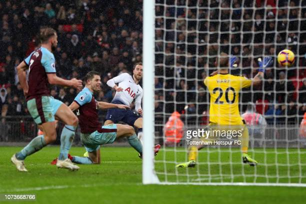 Christian Eriksen of Tottenham Hotspur scores his team's first goal during the Premier League match between Tottenham Hotspur and Burnley FC at...