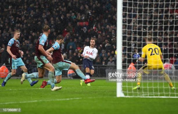 Christian Eriksen of Tottenham Hotspur scores his team's first goal during the Premier League match between Tottenham Hotspur and Burnley FC at...