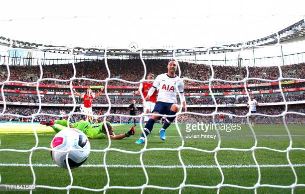 Christian Eriksen of Tottenham Hotspur scores his team's first goal during the Premier League match between Arsenal FC and Tottenham Hotspur at...