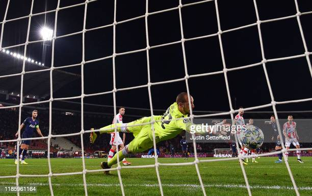 Christian Eriksen of Tottenham Hotspur scores his team's fourth goal past Milan Borjan of Crvena Zvezda during the UEFA Champions League group B...