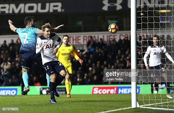 Christian Eriksen of Tottenham Hotspur scores his team's fourth goal during the Premier League match between Tottenham Hotspur and Swansea City at...