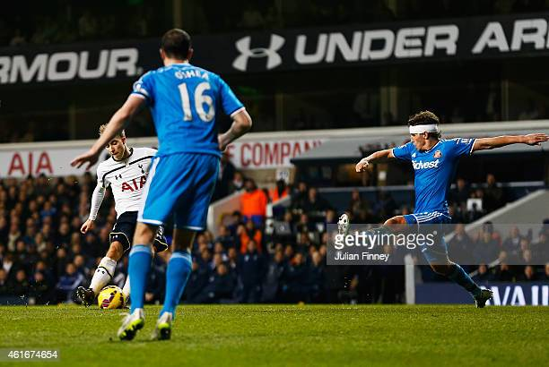Christian Eriksen of Tottenham Hotspur scores his team's second goal during the Barclays Premier League match between Tottenham Hotspur and...