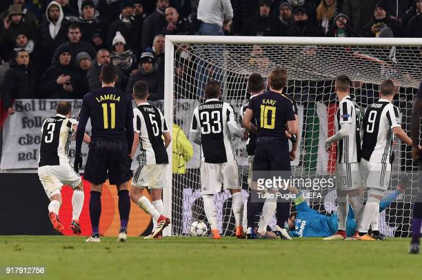 Christian Eriksen of Tottenham Hotspur scores the equalizing goal during the UEFA Champions League Round of 16 First Leg match between Juventus and...