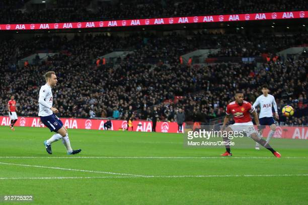Christian Eriksen of Tottenham Hotspur scores the opening goal during the Premier League match between Tottenham Hotspur and Manchester United at...