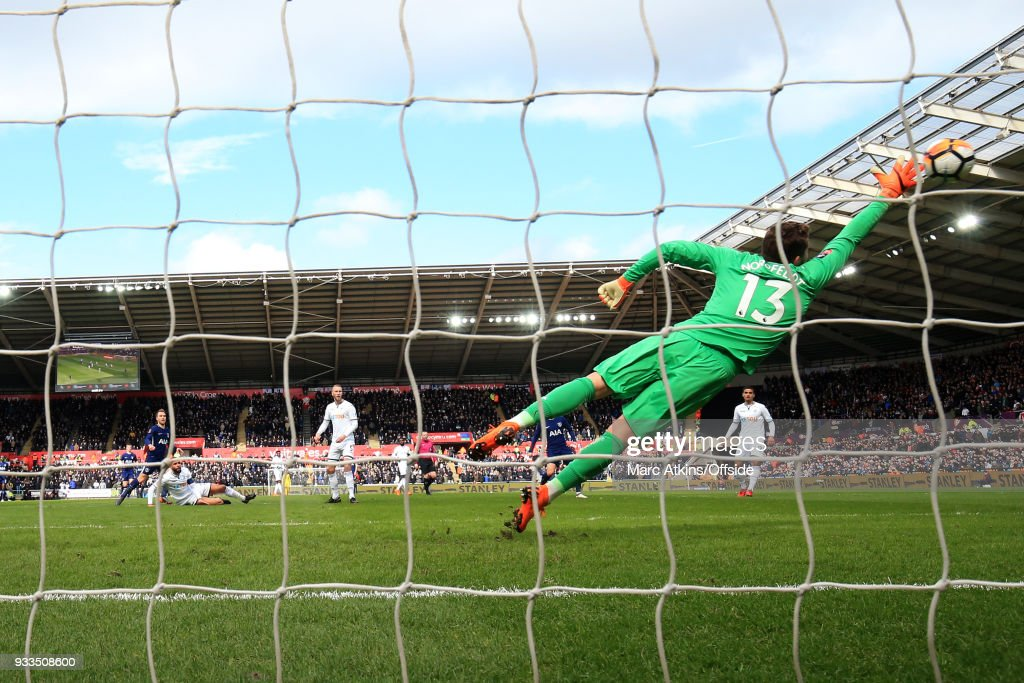 Christian Eriksen of Tottenham Hotspur scores the opening goal during the Emirates FA Cup Quarter Final match between Swansea City and Tottenham Hotspur at Liberty Stadium on March 17, 2018 in Swansea, Wales.