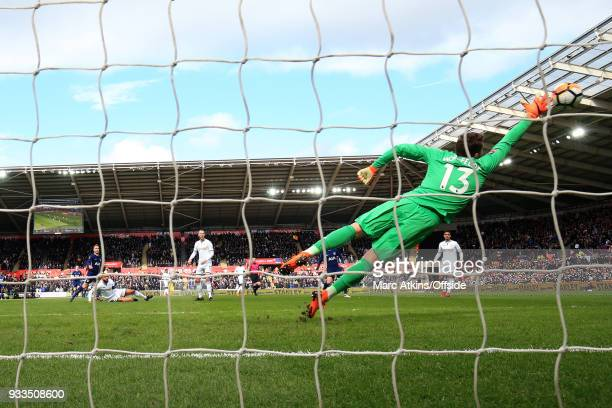 Christian Eriksen of Tottenham Hotspur scores the opening goal during the Emirates FA Cup Quarter Final match between Swansea City and Tottenham...
