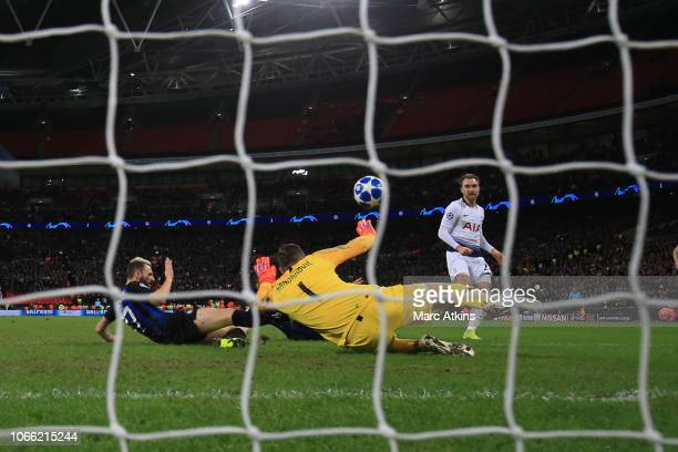 Christian Eriksen of Tottenham Hotspur scores the winning goal during the Group B match of the UEFA Champions League between Tottenham Hotspur and FC...