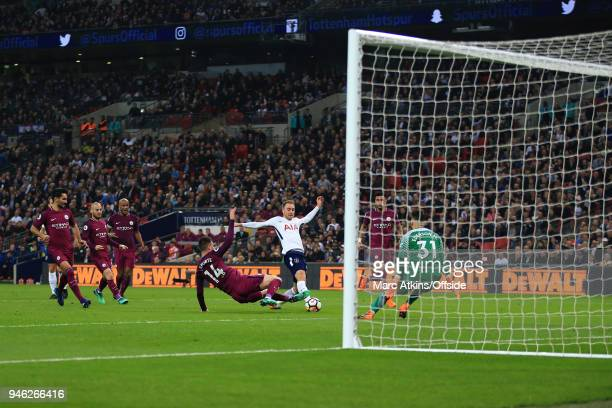 Christian Eriksen of Tottenham Hotspur scores their 1st goal during the Premier League match between Tottenham Hotspur and Manchester City at Wembley...