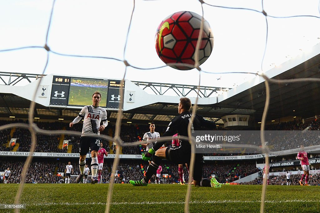 Christian Eriksen of Tottenham Hotspur scores their third goal past goalkeeper Artur Boruc of Bournemouth during the Barclays Premier League match between Tottenham Hotspur and A.F.C. Bournemouth at White Hart Lane on March 20, 2016 in London, United Kingdom.