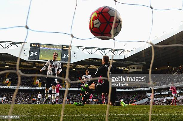 Christian Eriksen of Tottenham Hotspur scores their third goal past goalkeeper Artur Boruc of Bournemouth during the Barclays Premier League match...