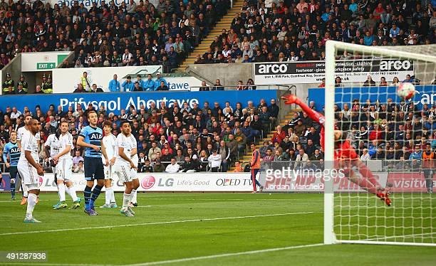 Christian Eriksen of Tottenham Hotspur scores Tottenham's second goal during the Barclays Premier League match between Swansea City and Tottenham...