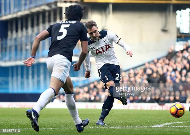 Christian Eriksen of Tottenham Hotspur shoots and his shot is deflected by Gareth McAuley of West Bromwich Albion for Tottenham Hotspur's second goal...