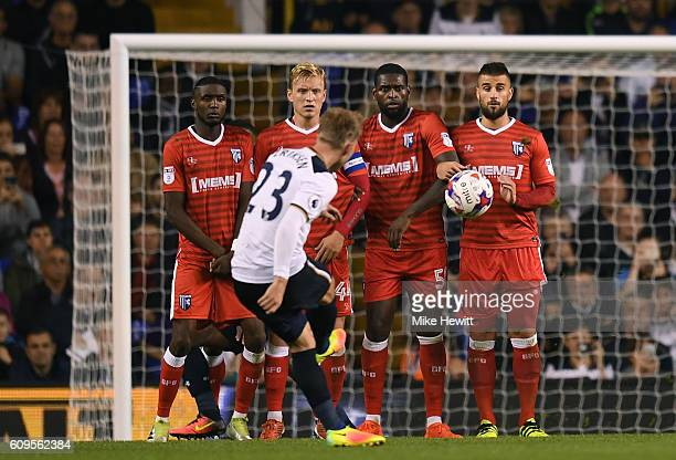 Christian Eriksen of Tottenham Hotspur shoots on goal during the EFL Cup Third Round match between Tottenham Hotspur and Gillingham at White Hart...
