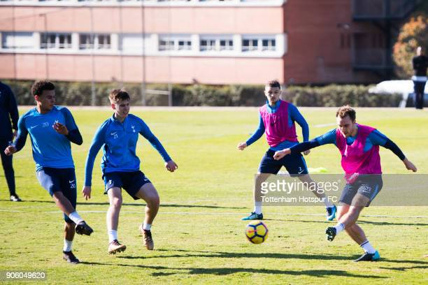 Christian Eriksen of Tottenham Hotspur shoots on goal under pressure from Dele Alli and Juan Foyth during a training session during day three of the...
