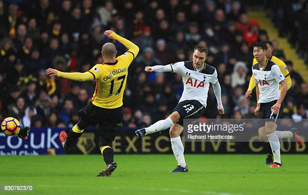 Christian Eriksen of Tottenham Hotspur shoots past Adlene Guedioura of Watford during the Premier League match between Watford and Tottenham Hotspur...
