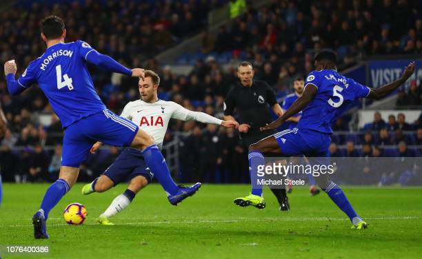 Christian Eriksen of Tottenham Hotspur shoots past Sean Morrison and Bruno Ecuele Manga of Cardiff City as he scores his team's second goal during...