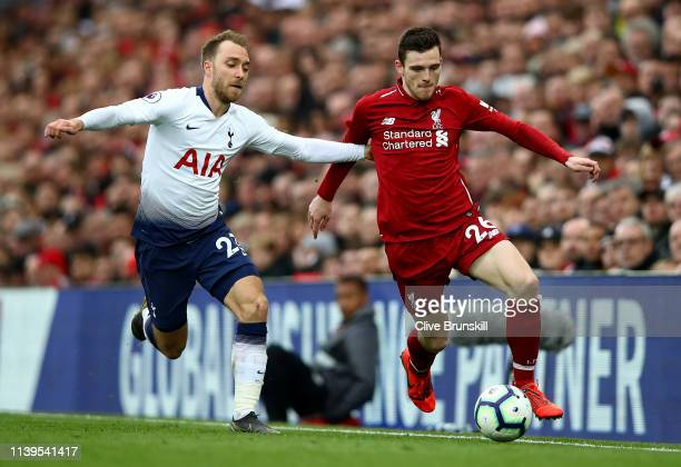 Christian Eriksen of Tottenham Hotspur tackles Andrew Robertson of Liverpool during the Premier League match between Liverpool FC and Tottenham...