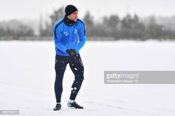 Christian Eriksen of Tottenham Hotspur throws a snowballs during a Tottenham Hotspur Training Session on December 11 2017 in Enfield England