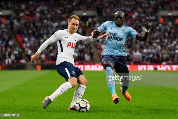 Christian Eriksen of Tottenham Hotsur is challenged by Mohamed Diame of Newcastle United during the Premier League match between Tottenham Hotspur...