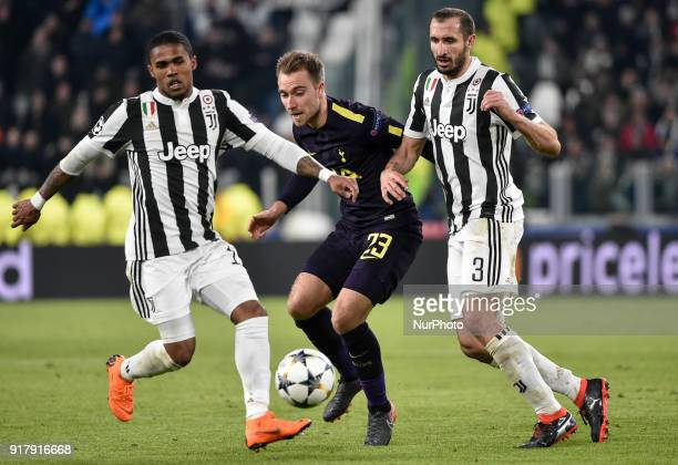 Christian Eriksen of Tottenham is challenged by Douglas Costa of Juventus and Giorgio Chiellini of Juventus during the UEFA Champions League Round of...