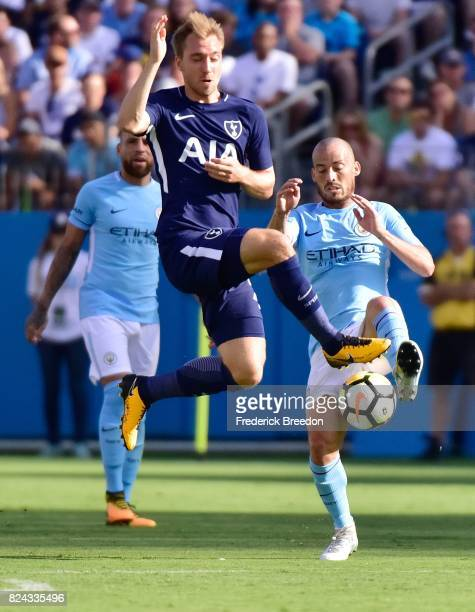 Christian Eriksen of Tottenham jumps to deflect the ball against Manchester City during the first half of the 2017 International Champions Cup...