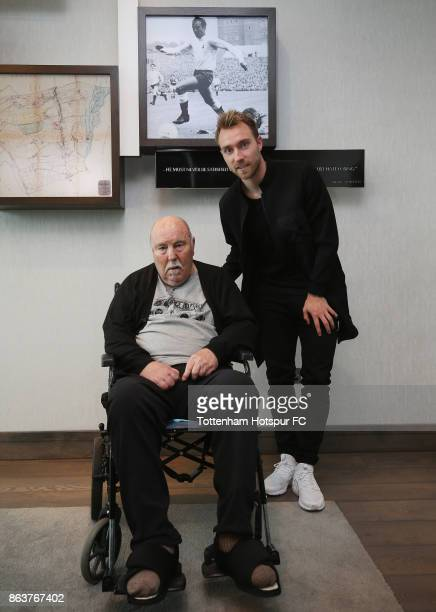 Christian Eriksen of Tottenham meets former Tottenham player Jimmy Greaves at the Tottenham Hotspur Training Centre on October 20, 2017 in Enfield,...