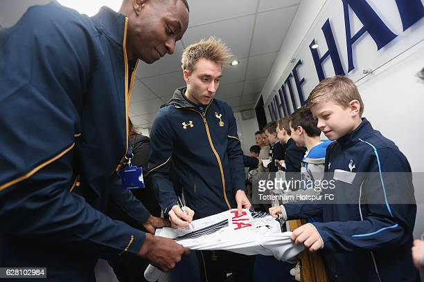 Christian Eriksen of Tottenham signs autographs for mascots prior to the Premier League match between Tottenham Hotspur and Swansea City at White...