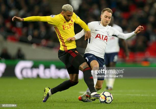 Christian Eriksen of TottenhamHotspur is challenged by Etienne Capoue of Watford during the Premier League match between Tottenham Hotspur and...