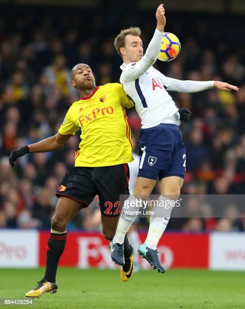 Christian Eriksen of TottenhamHotspur is challenged by Marvin Zeegelaar of Watford during the Premier League match between Watford and Tottenham...