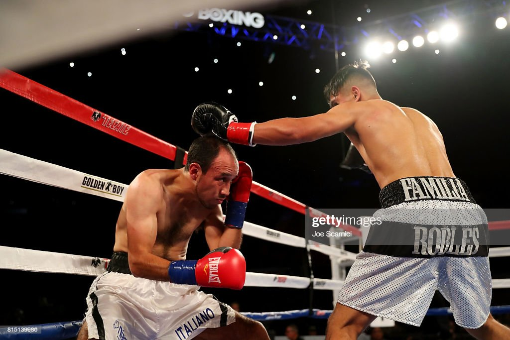 Christian Esquivel ducks under a punch from Manny Robles Jr. at The Forum on July 15, 2017 in Inglewood, California.
