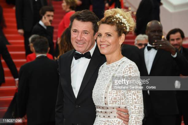 Christian Estrosi and Laura Tenoudji attend the screening of A Hidden Life during the 72nd annual Cannes Film Festival on May 19 2019 in Cannes France