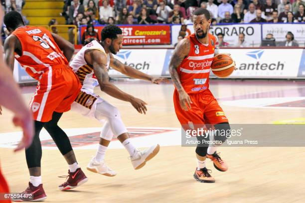 Christian Eyenga and Eric Maynor of Openjobmetis competes with MarQuez Haynes of Umana during the LegaBasket of Serie A1 match between Reyer Umana...