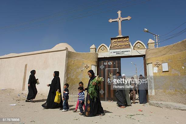 Christian families leave St Tawdros Coptic Orthodox Christian Monastery Luxor Nile Valley Egypt The Copts are an ethnoreligious group in North Africa...
