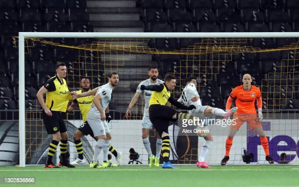 Christian Fassnacht of BSC Young Boys scores their sides first goal past Niklas Lomb of Bayer 04 Leverkusen during the UEFA Europa League Round of 32...