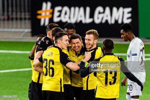Christian Fassnacht of Young Boys celebrating his opening goal with his teammates during the UEFA Europa League Round of 32 match between BSC Young...