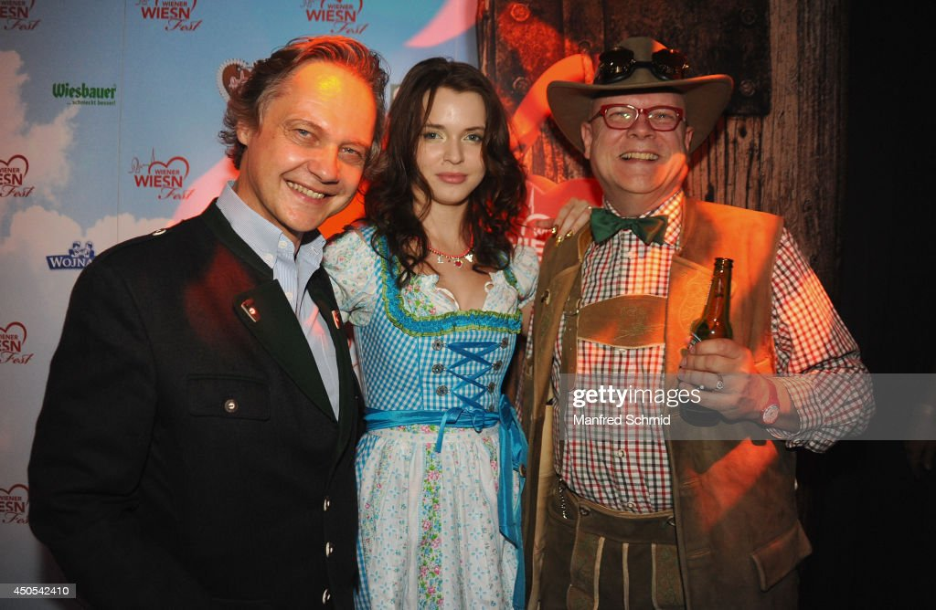 Christian Feldhofer, Roxanne Rapp and Conrad Seidl aka Bierpapst pose for a photograph during the beauty competition 'Miss Wiener Wiesn-Fest 2014' at Platzhirsch on on June 12, 2014 in Vienna, Austria.